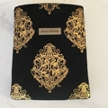 Black velvet padded book sleeve.