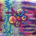 Colourful embellished knit women's fingerless gloves with beaded butterfly motif