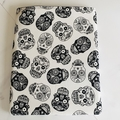 Sugar skull padded book sleeve.