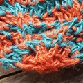 crocheted shopping carry string bag made from hemp yarn in turquoise and orange