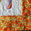 Embroidered fancy shoe place mat, art quilt, candle mat, Mardi Gras shoe