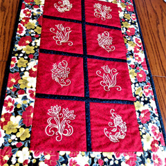 Embroidered patchwork table runner, gold and red