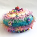 Colourful embellished knit hat for child from 3-6 years. Beads and textures.