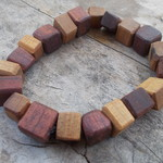 bangle made from timber beads hand tooled from reclaimed hardwoods and cedar