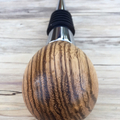 Wine bottle stopper, chrome, hand turned from Zebrano wood.