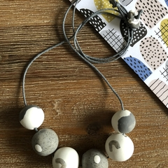 Handmade polymer clay necklace | Grey granite | Polka dot and boomerang