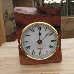 Clock, gold, made from Australian red gum Burl.