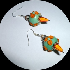 Free postage.Handmade glass, crystal and miracle bead earrings with silver trim.
