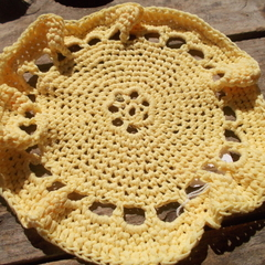 Round, cornsilk washcloth in butter yellow natural fibre