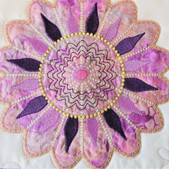 Quilted Embroidered Patchwork Table Topper, applique embroidered fancy flower