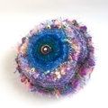 Colourful embellished knit hat for 7-14 years with beads and textures.