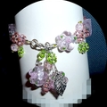 Hand made pink and green glass flowers bracelet. Postage free