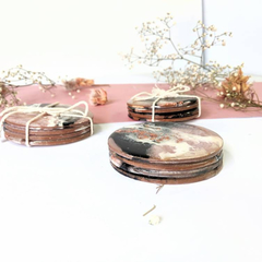 Sets of four round unique handmade resin coasters in dusty pink, white, black an