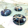 Sets of four round unique handmade resin coasters in blue, copper, black and gre