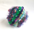 Colourful unique embellished hat for 7-14 years. Features beads and textures.