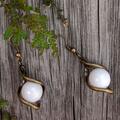 White Stone Twist Earrings