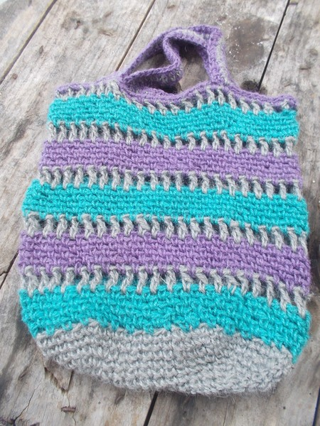 crocheted shopping string bag made from hemp yarn in turquoise purple and grey