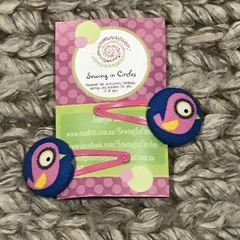 Blue and pink birdie hair clips