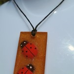 Resin gold glitter pendant with wooden ladybugs