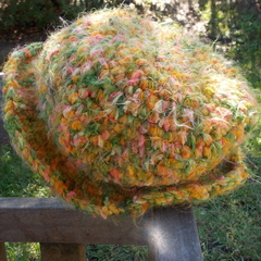 crocheted hat with brim in acrylic yarn. Green, orange and yellows ON SALE!!