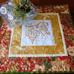Christmas Patchwork quilted and embroidered table topper, gold red and green fol