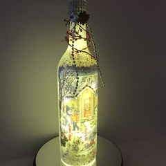 Christmas themed bottle with string lights