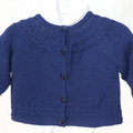 Pure wool baby cardigan with circular lace yoke