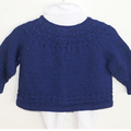 Pure wool baby cardigan with circular lace yoke