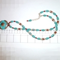 Nepal style pendant with turquoise, glass and enamel chain.