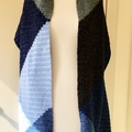 Knitted geometric wrap or generous scarf