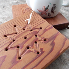 Trivet hand tooled from reclaimed Canadian Cedar with star pattern. 25% off!