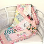 Pretty quilt for baby or toddler.  Lightweight but snug.