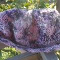 knitted slouch beanie made from acrylic and mohair yarn. Pink, grey and white.