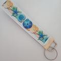Blue and beige seashell key fob wristlet