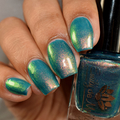 "Nail polish - ""Botanical Musings"" A dark teal green with shimmer."