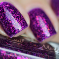 "Nail polish - ""Half Orange"" A dark purple base with iridescent flakes"