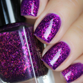 "Nail polish - ""Half Orange"" A dark purple base with iridescent flakes"