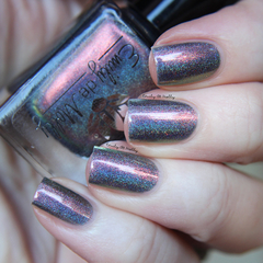 "Nail polish - ""Fame And Decadence"" A dark grey holo with shimmer."