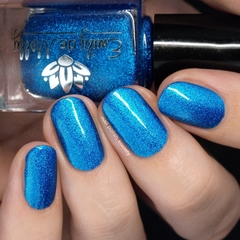 "Nail polish - ""Out Cold"" A bright blue metallic flake in a blue base."