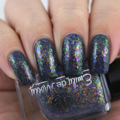 "Nail polish - ""Ornate Print"" A dark grey base with iridescent flakes"