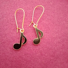 Black and gold music note earrings