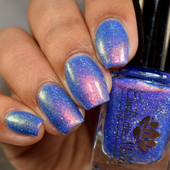 "Nail polish - ""Test Subject"" A bright cornflower blue with shimmer."
