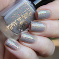 "Nail polish - ""Dull Beings"" A pale grey/beige base with iridescent flakes"