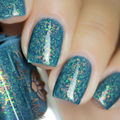 "Nail polish - ""The Missing"" A steel blue base with iridescent flakes"
