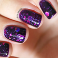 """Nail polish - """"Cosmic Forces"""" A purple base with assorted holographic glitters"""
