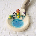 Ceramic and Driftwood Spoon with Miniature Houses and Pond