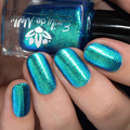 "Nail polish - ""Say The Word"" A vibrant teal green base with aurora pigment"