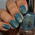 """Nail polish - """"The Missing"""" A steel blue base with iridescent flakes"""