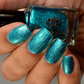 "Nail polish - ""Speculation"" A turquoise green metallic flake"