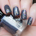 """Nail polish - """"Ornate Print"""" A dark grey base with iridescent flakes"""